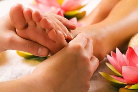 Woman enjoying a feet massage in a spa setting (close up on feet) Stock Photo - 3307472