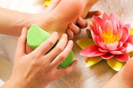 Woman enjoying a feet massage in a spa setting (close up on feet) Stock Photo - 3307476