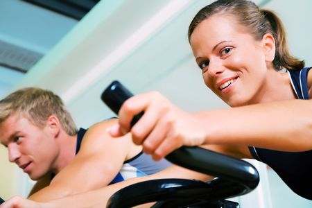 static bike: Couple spinning in a club Stock Photo