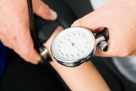 Doctor measuring blood pressure, close-up Stock Photo - 3468714