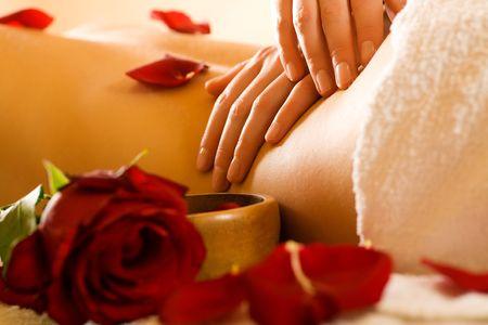 Woman enjoying a massage in a spa setting Stock Photo - 3468704