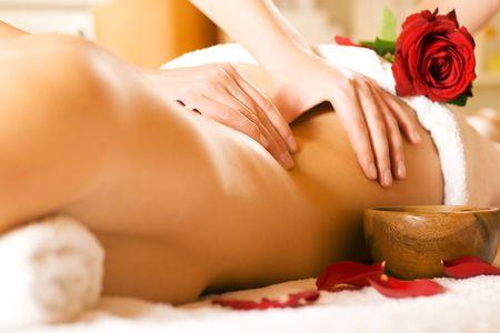 Woman enjoying a massage in a spa setting Stock Photo - 3468701
