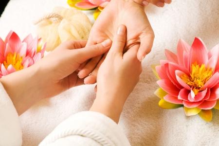 massaging: Woman getting a hand massage (close up on hands)