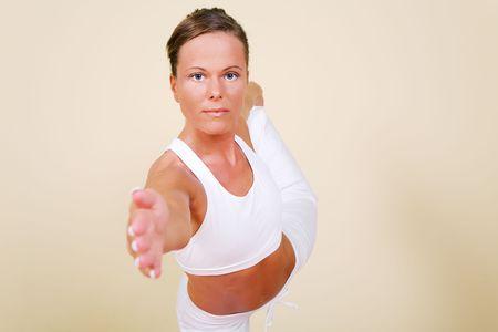 nata: Young woman in a yoga position (Nata Rajasana)
