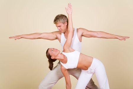trikonasana: Couple (male  female) doing yoga exercises together Stock Photo