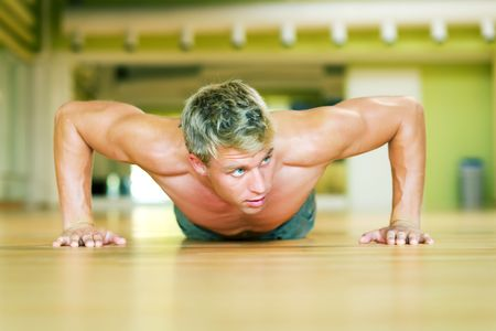 Strong, handsome man doing push-ups Stock Photo - 3555062