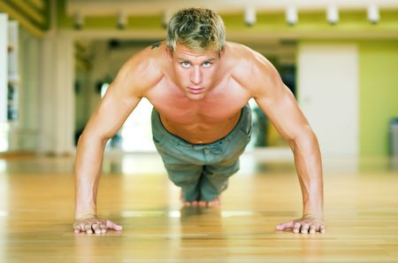 Strong, handsome man doing push-ups Stock Photo - 3555013