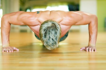 Strong, handsome man doing push-ups Stock Photo - 3555041