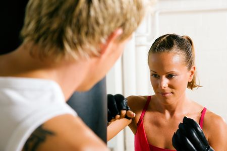Boxing couple (male  female), trainer supervising the boxing student