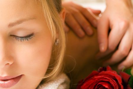 Beautiful blonde girl getting a massage and feeling visibly good about it Stock Photo - 3614262