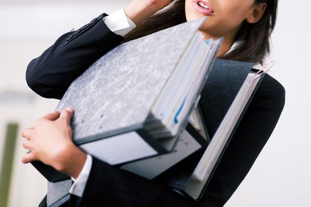 Woman in a office (just torso) doing different things at the same time Stock Photo - 3623656