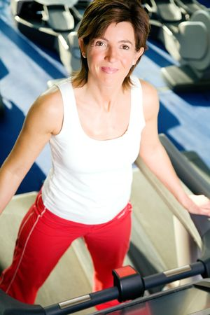 Woman on the treadmill, having a short break and looking around Stock Photo - 6094180