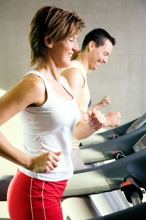 People exercising by  running on the treadmill in a gym Stock Photo - 6094164