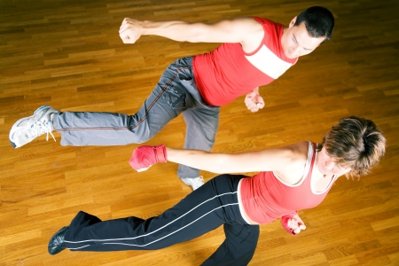 moves: Sparring session in martial arts moves, couple exercising Stock Photo