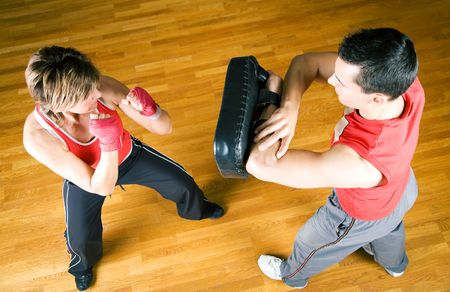 boxing training: Couple practicing martial art moves in a sparring