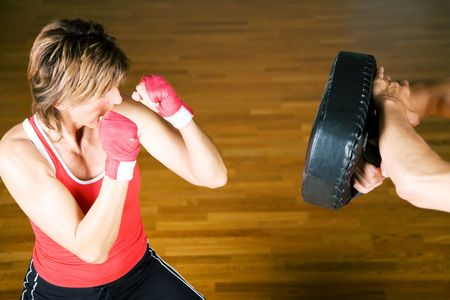 toughness: Sparring session in martial  arts performed by a couple, fists raised Stock Photo
