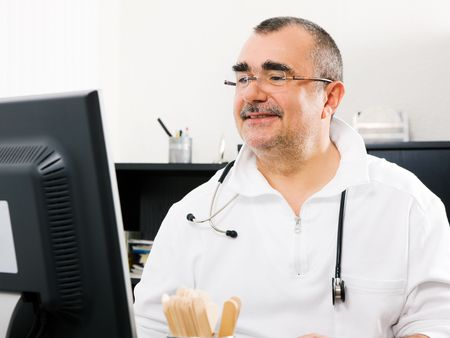 Doctor looking at a computer screen photo