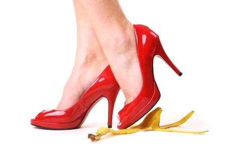 Red shoes and a banana skin Stock Photo - 6094172