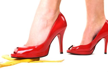Red shoes and a banana skin Stock Photo - 6094171