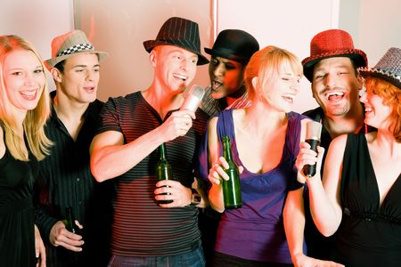 Group of friends (male and female) celebrating a rather funny party like a birthday or new years eve Stock Photo - 6082015