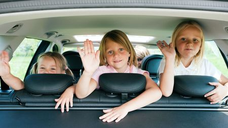 Family with three kids in a car Stock Photo - 6081062