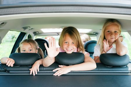 family of five: Family with three kids in a car