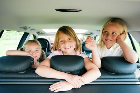 Family with three kids in a car Stock Photo - 6081061