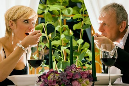 Couple having dinner in restaurant photo
