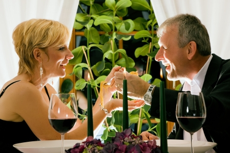 Couple having dinner in restaurant Stock Photo - 6092332