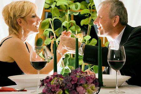 Couple having dinner in restaurant Stock Photo - 6092632