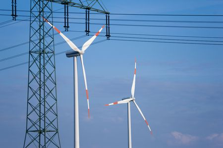 Wind turbines and in the foreground a power transmission line photo