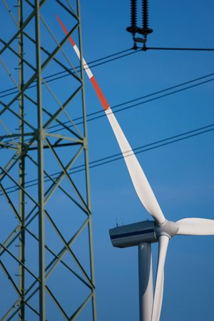 Wind turbine and in the foreground a power transmission line photo