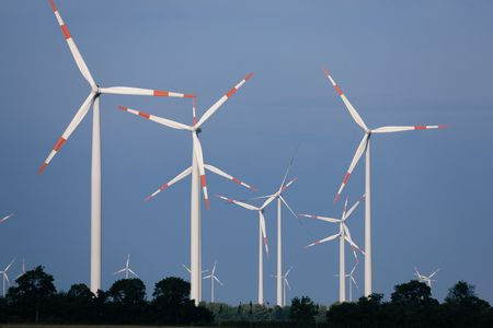 Whole park of wind turbines in front of a clear blue sky photo