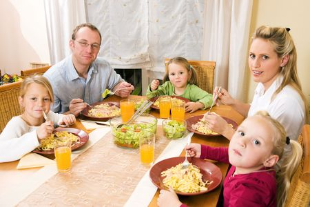 Family - parents and children - eating lunch or dinner photo