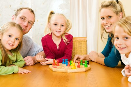 game board: Family playing a board game,