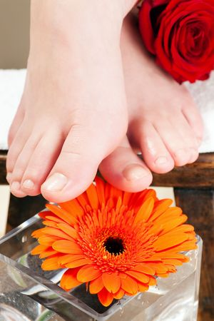 shoeless: Feet in a wellness setting sitting on a footstool Stock Photo
