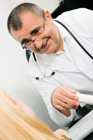 adverse reaction: Doctor with his patient in a consultation explaining the benefits of a drug Stock Photo