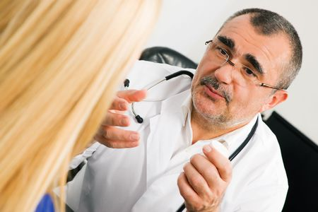 adverse reaction: Doctor with his patient in a consultation