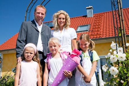 Family with three kids sending them to school photo