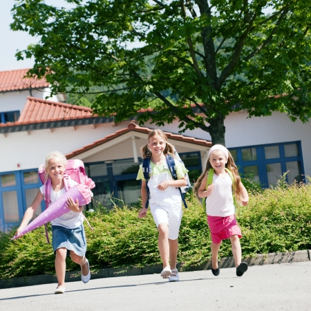 kids having fun at school running at the viewer with their