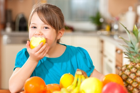 family eating: Child eating an apple Stock Photo