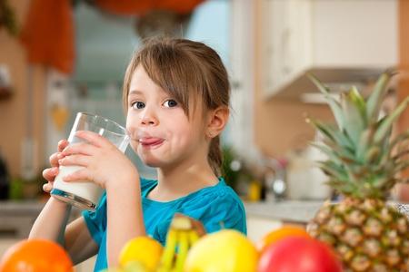 girl drinking: Child drinking milk Stock Photo