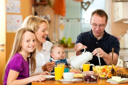 family health: Family having breakfast