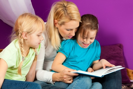 nanny: Mother is reading a book Stock Photo