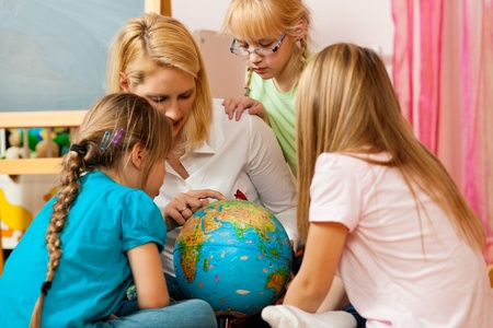 private schools: Mother explaining the world to her children Stock Photo