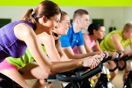 cardio fitness: Indoor bycicle cycling in gym Stock Photo