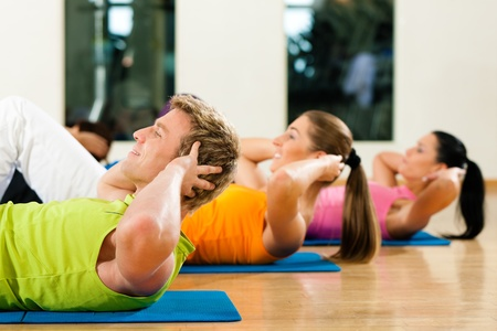 Sit-ups in gym for fitness Stock Photo - 9415527