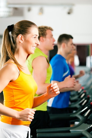 People in gym on treadmill running Stock Photo - 9415511