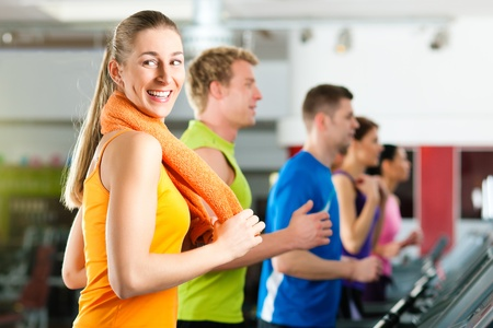 People in gym on treadmill running Stock Photo - 9415524