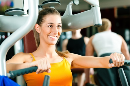 Woman in gym on machine exercising   Stock Photo - 9415567